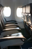 Empty airplane seats in the cabin in the morning flight Stock Photography