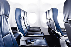 Empty airplane seats - economy or coach class stock photos