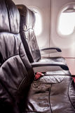 Empty airplane seats and window Royalty Free Stock Images
