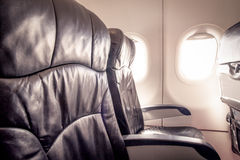 Empty airplane seats and window Royalty Free Stock Photo
