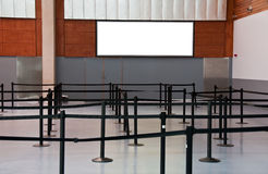 Empty airport check in line with advert space sign Stock Photo