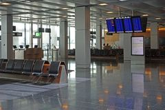 Empty airport departure lounge waiting area with flight informat Royalty Free Stock Photos