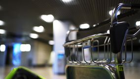 Empty airport luggage cart stock video
