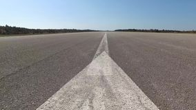 Empty airport runway low angle stock video footage