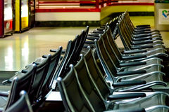 Empty airport seating - typical black chairs in boarding waiting Stock Photo