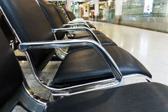 Empty airport terminal waiting area with chairs. Royalty Free Stock Photos