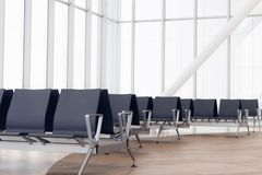 Empty airport terminal waiting area with chairs. Close up photo royalty free stock photography