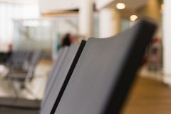 Empty airport terminal waiting area with chairs. Close up photo stock photo