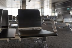 Empty airport terminal waiting area with chairs. Travel concept Royalty Free Stock Image