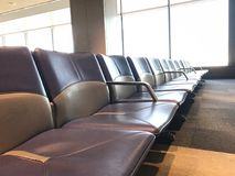 Empty airport terminal waiting area with seats Royalty Free Stock Photography