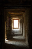Empty aisle in an ancient buddhist monastery Stock Images