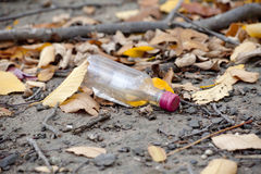Empty Alcohol Bottle. On the ground Royalty Free Stock Images