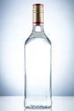 Empty alcohol glass bottle Royalty Free Stock Image