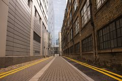 Empty alley found on a rainy day in downtown London. While walking around Royalty Free Stock Photos