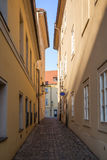 Empty alley in Prague. Narrow and empty alley or pedestrian street on the Kampa Island in Prague, Czech Republic Stock Image