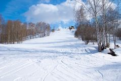 Empty alpine ski slope in sunny winter day Royalty Free Stock Photography