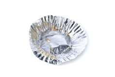 Empty aluminium foil with crumb on white Royalty Free Stock Photography