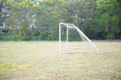 Empty amateur football goal. Posts and nets Stock Photos
