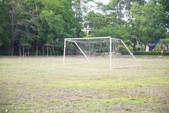 Empty amateur football goal. Posts and nets Royalty Free Stock Photo