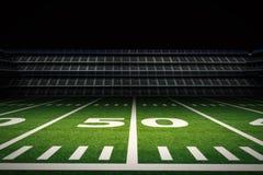 Empty american football stadium at night Royalty Free Stock Photo