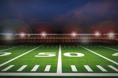 Empty american football stadium at night Stock Photography