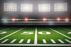 Empty american football stadium at night Royalty Free Stock Images