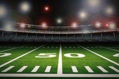 Empty american football stadium at night Stock Images
