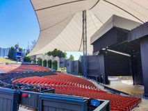 The stage from left field. An empty Amphitheater with a stage set up for anyone to rock out or sing like an opera diva Royalty Free Stock Photography