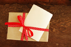 Empty ancient photograph and gift packing with a red bow in peas Royalty Free Stock Photos