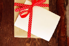 Empty ancient photograph and gift packing with a red bow in peas Stock Photography