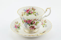 Empty antique cup and saucer with rose decoration isolated on white - English tea royalty free stock photos
