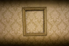 Empty antique frame hanging on wallpaper Royalty Free Stock Images