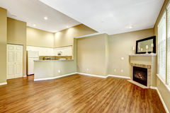 Empty apartment with open floor plan.  Living room with fireplac Stock Image