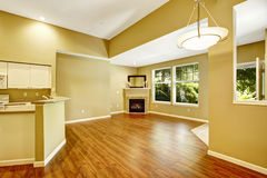 Empty apartment with open floor plan.  Living room with fireplac Stock Images