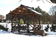 Empty arbor among the winter forest. Pavilion for a picnic in the winter forest.  Royalty Free Stock Photos