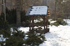 Empty arbor among the winter forest. Pavilion for a picnic in the winter forest.  Royalty Free Stock Photo