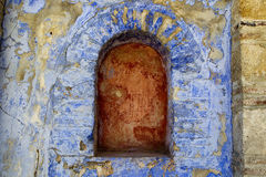 Empty arch indent on an old building. Archway in a brick colorfull stone wall at Hilandar Monastery on the southwest side of the peninsula of Mount Athos in Stock Photos