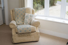 Empty armchair by a window Royalty Free Stock Photo