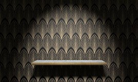 Empty Art Deco Shelf On Wall. An empty marble and gold trimmed shelf on a wall clad in art deco styled wallpaper pattern in gold and black Royalty Free Stock Image