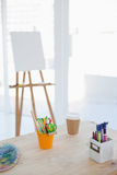 Empty artists room with canvas on background. Empty bright artists room with canvas and easel on background Royalty Free Stock Images