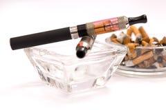 Empty ashtray with e-cigarette. E-cigarette cleaner than ordinary cigarettes Stock Image