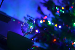 Empty askew wine glass and abstact night blury defocus bokeh light background photography Royalty Free Stock Photography