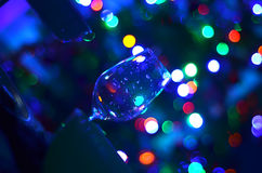 Empty askew wine glass detail and abstact night blury defocus bokeh light background photography Stock Image