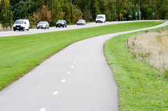 Empty asphalt bike path and motor road Royalty Free Stock Image