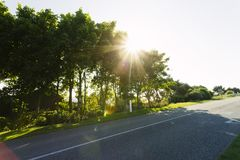 Empty Asphalt Country Road Passing Through Green Fields And Forests. Countryside Landscape On Sunny Spring Day In France Stock Photos