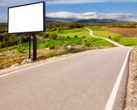 Empty asphalt road and blank billboard Stock Images