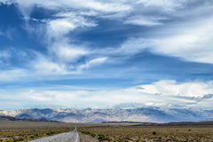 Empty asphalt road with cloudy sky and sunlight Royalty Free Stock Photos