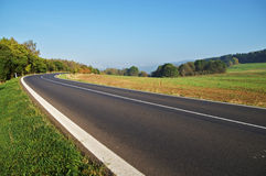 Empty asphalt road in countryside, bend of road Stock Images