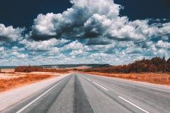 Empty asphalt road at daytime. Beautiful nature landscape Stock Photo