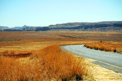 Empty asphalt road in Golden Gate Highlands National Park Royalty Free Stock Photography